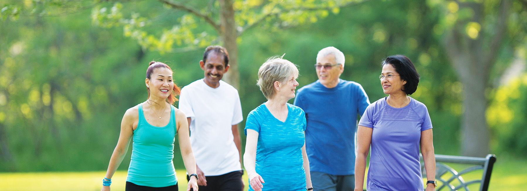 Five seniors walking together for better health and fitness
